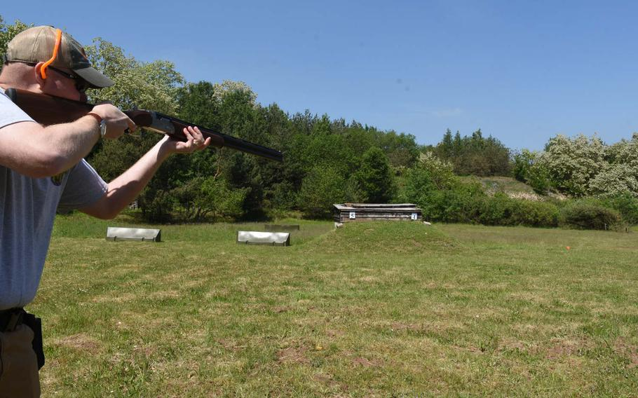Brandon Cowell, the hunting coordinator for KMC Outdoorsmen, aims his shotgun at a flying clay at one of the ranges at the Kaiserslautern Rod and Gun Club in Kaiserslautern, Germany, in May.