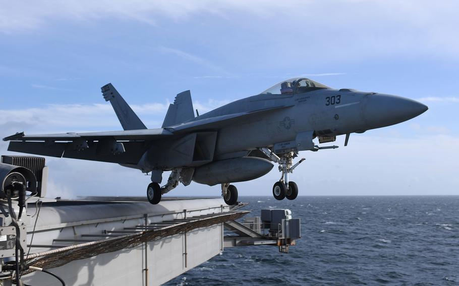 """An F/A-18E Super Hornet, assigned to the """"Knighthawks"""" of Strike Fighter Squadron (VFA) 136, launches from the Nimitz-class aircraft carrier USS Harry S. Truman as it operates in the North Sea on Sept. 30, 2018."""
