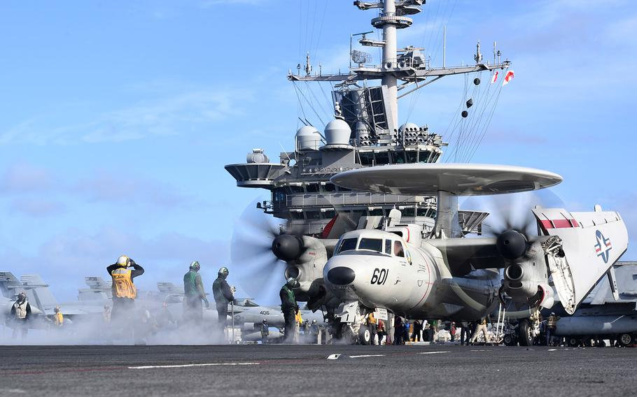"""An E-2D Hawkeye, assigned to the """"Seahawks"""" of Carrier Airborne Early Warning Squadron (VAW) 126, prepares to launch off the flight deck aboard the Nimitz-class aircraft carrier USS Harry S. Truman  on Sept. 30, 2018 as the strike group operates in the North Sea."""
