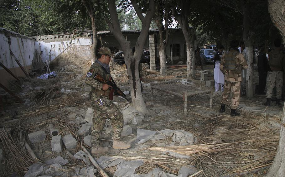 Afghan Security personnel inspect the site of a suicide attack in the Kama district of Nangarhar province, east of Kabul, Afghanistan, on Tuesday, Oct. 2, 2018. The suicide bomber struck an election rally on Tuesday, killing at least 13 people and wounding more than 30, a provincial official said.