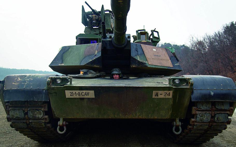 An M1A2 Abrams tank gears up for qualification at Rodriguez Live Fire Range, South Korea, Tuesday, Nov. 28, 2017.