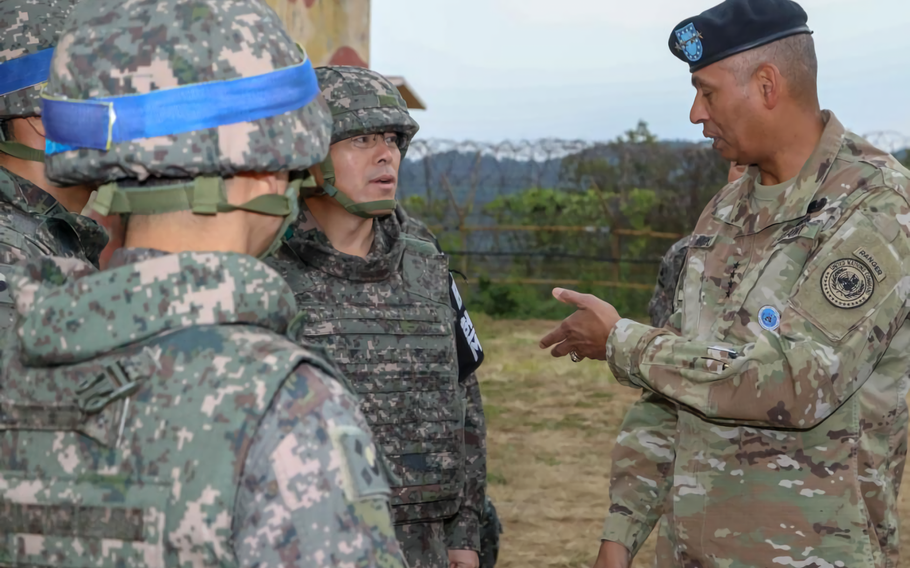 U.S. Army Gen. Vincent K. Brooks, Commander of United Nations Command, discusses the current land mine removal efforts ongoing at Arrowhead Hill in the Demilitarized Zone with Republic of Korea Army personnel.