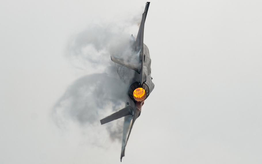 In an August 18, 2018 file photo, Capt. Andrew Olson, F-35 Heritage Flight Team commander and pilot, pulls a tactical pitch in an F-35A Lightning II during the Chicago Air and Water Show in Chicago.