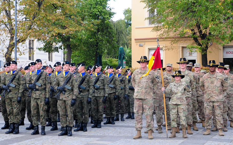 """Soldiers assigned to Headquarters and Headquarters Company, 1st Armored Brigade Combat Team, 1st Cavalry Division, stand in formation alongside the Polish 11th """"Lubuska"""" Armored Cavalry Division soldiers during a ceremony to observe the Black Division Day in Zielona Gora, Poland, Sept. 21, 2018."""
