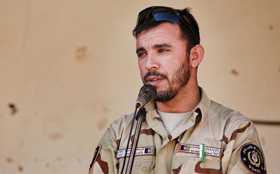 Gen. Abdul Raziq, Kandahar police chief, speaks to locals during a shura on Oct. 22, 2013.