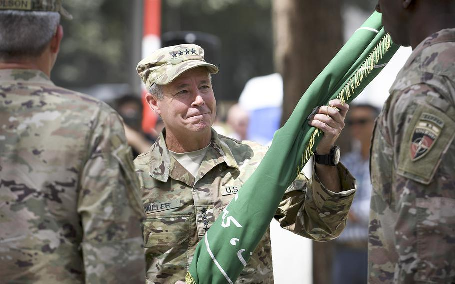 """Gen. Austin Scott Miller assumes command of NATO forces in Afghanistan in a ceremony Sept. 2, 2018, in Kabul. Miller was the target of a Taliban attack on Thursday, Oct. 18, that killed an Afghan general and a local intelligence chief in Kandahar province. Miller was """"uninjured,"""" according to military officials."""