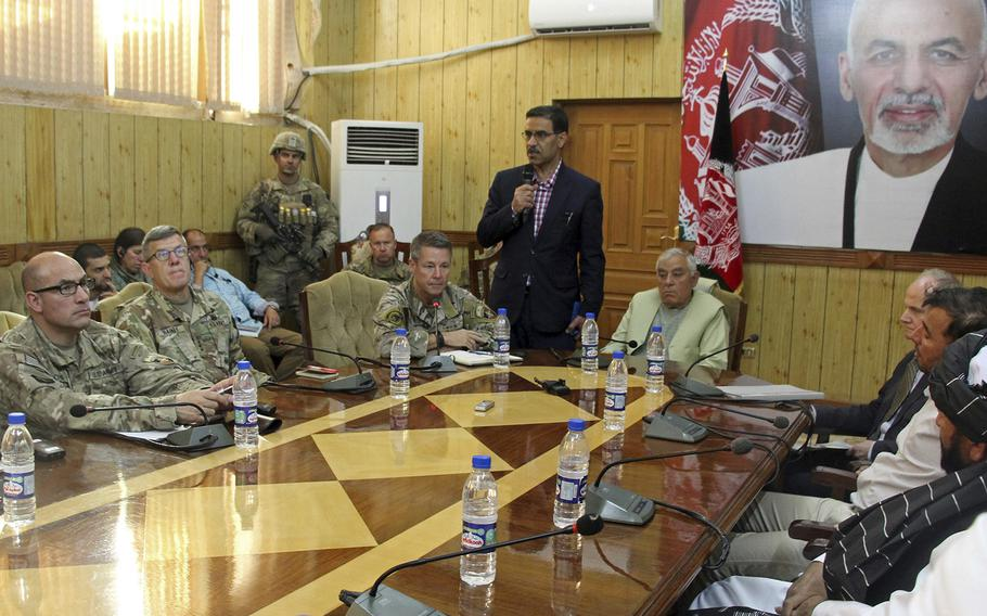 The head of NATO troops in Afghanistan, Gen. Scott Miller, center left, Kandahar Gov. Zalmay Wesa, center right, and their delegations attend a security conference, in Kandahar, Afghanistan, on Thursday, Oct. 18, 2018. Wesa was amongh three top officials in Afghanistan's Kandahar province who were killed when their own guards opened fire on them at the conference, the deputy provincial governor said. A Taliban spokesman said the target was Miller, who escaped without injury, according to NATO.