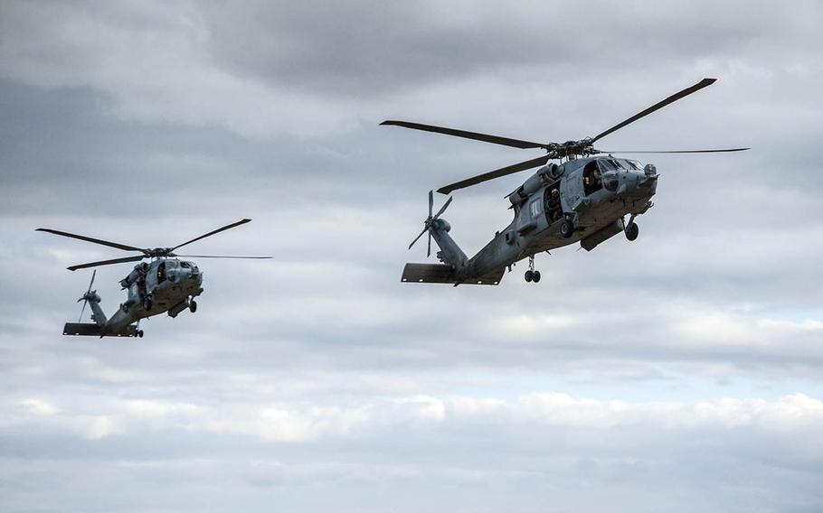 Two Navy HH-60H Seahawk helicopters assigned to Helicopter Sea Combat Squadron 85 prepare to land in Rockhampton, Australia, July 13, 2017.