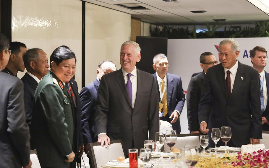 U.S. Defense Secretary Jim Mattis, center, and Singapore's Defense Minister Ng Eng Hen, front right, attend the ASEAN Defense Ministers' Meeting in Singapore Friday, Oct. 19, 2018.