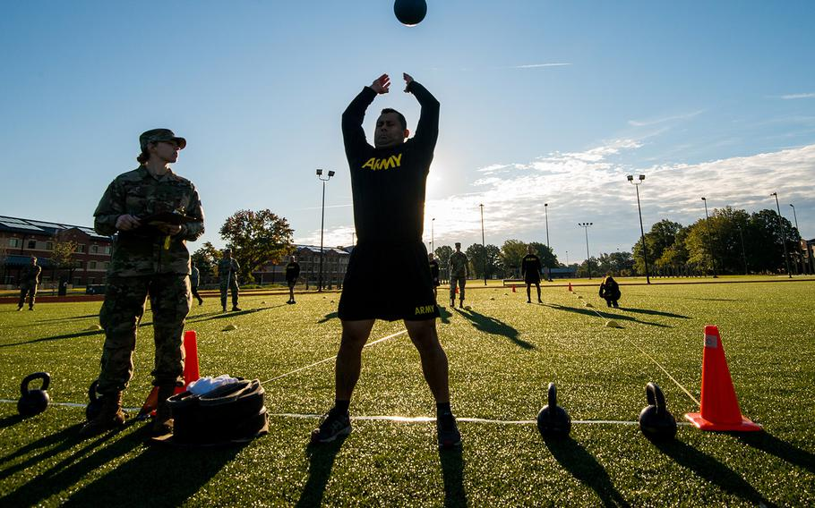 A soldier with the 128th Aviation Brigade at Fort Eustis, Va., attempts the standing power throw during a demonstration Tuesday, Oct. 23, 2018, of the Army's new six-event Army Combat Fitness Test.