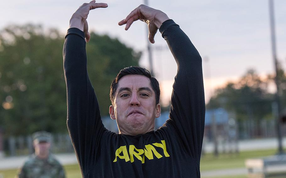 A soldier with the 128th Aviation Brigade at Fort Eustis in Vriginia attempts the standing power throw during a demonstration Tuesday, Oct. 23, 2018, of the Army's new Army Combat Fitness Test, which is scheduled to be fully implemented across the service by October, 2020.