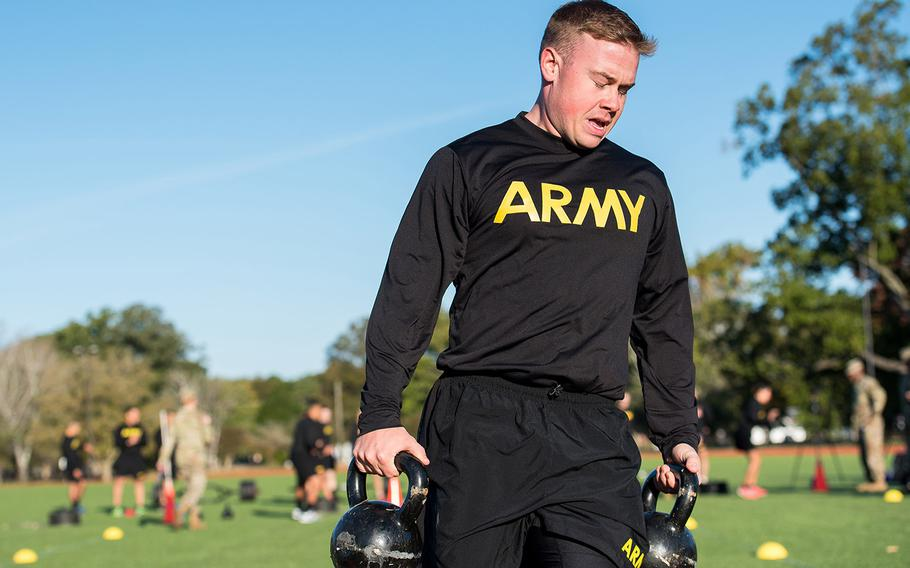 Army Staff Sgt. Brandon Powell carries 40-pound kettle bells during the sprint-drag-carry event, one of six parts of the Army Combat Fitness Test, during a demonstration Tuesday, Oct. 23, 2018 at Fort Eustis, Va.