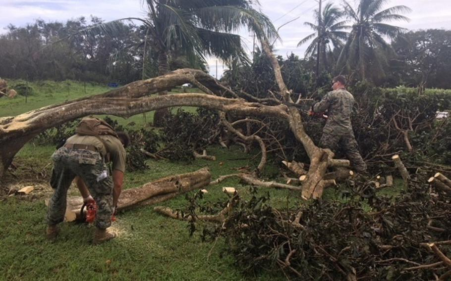 U.S. Marines and Navy Seabees clear debris from Typhoon Mangkhut on Tinian, Northern Marianas Islands, Sept. 11, 2018. Another storm hit the U.S. Commonwealth of the Northern Mariana Islands on Thursday, Oct. 25, 2018.