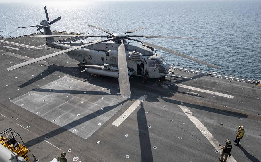 A CH-53E Super Stallion helicopter prepares for flight operations on the flight deck of the USS Essex in the Arabian Sea on Oct. 21, 2018.