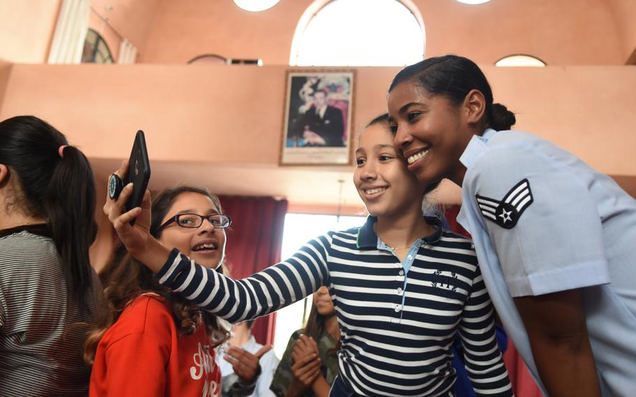 Senior Airman Sierra Bailey, a vocalist with the U.S. Air Forces in Europe Band, takes a selfie with a student at The American School in Marrakech, Morocco, on Oct. 23, 2018. Bailey and other band members traveled to Morocco last month for a number of various concerts and engagements in support of U.S. military interests.