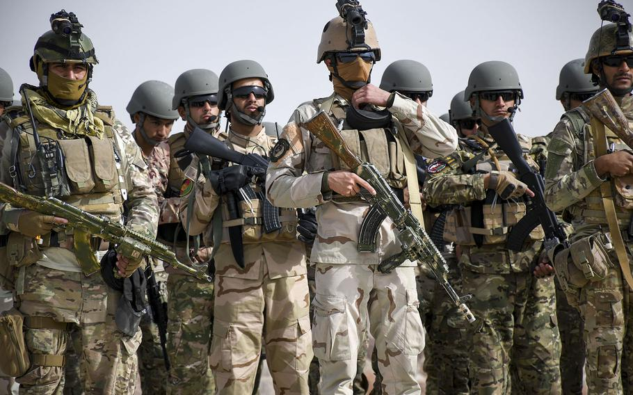 Afghan members of an elite police special forces unit in Herat gather for a drill prior to a raid to nab a Taliban leader Oct. 28, 2018.