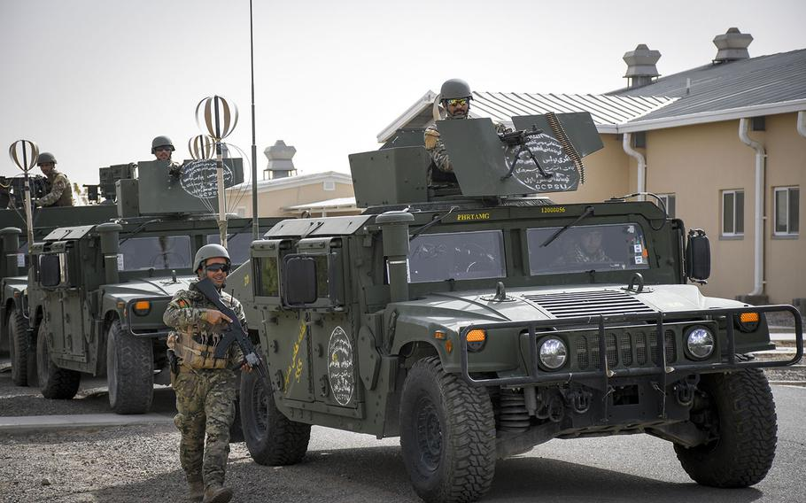 Afghan members of an elite police special forces unit in Herat prepare their vehicles during a drill prior to a raid to nab a Taliban leader Oct. 28, 2018. The new unit is one of six National Mission Units, who are better equipped and trained than normal Afghan police units.