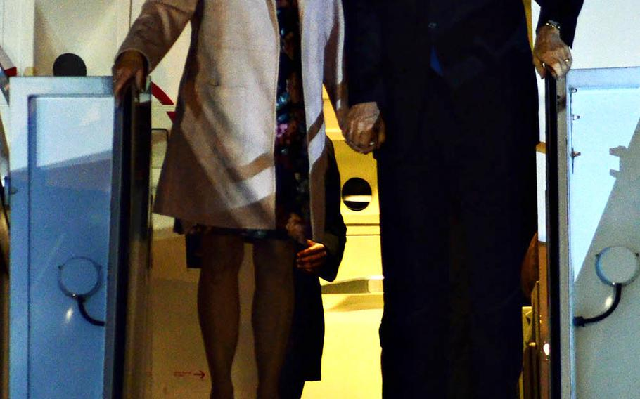 Vice President Mike Pence and his wife, Karen, arrive at Yokota Air Base, Japan, Monday, Nov. 13, 2018.