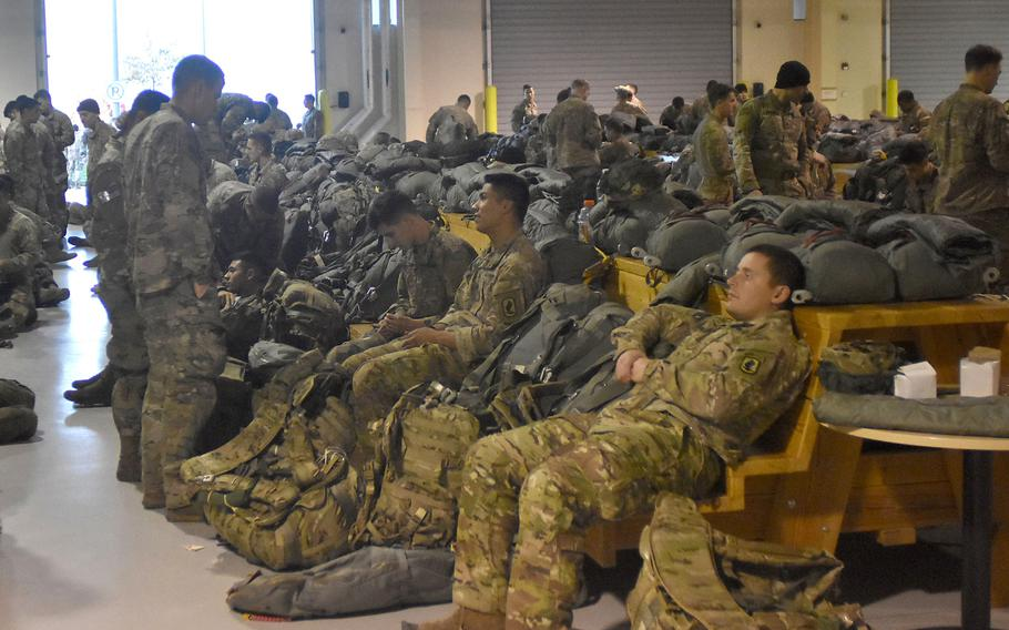 The personnel alert holding area at Aviano Air Base, Italy, is a busy place when the 173rd Airborne Brigade comes to gear up for a jump.