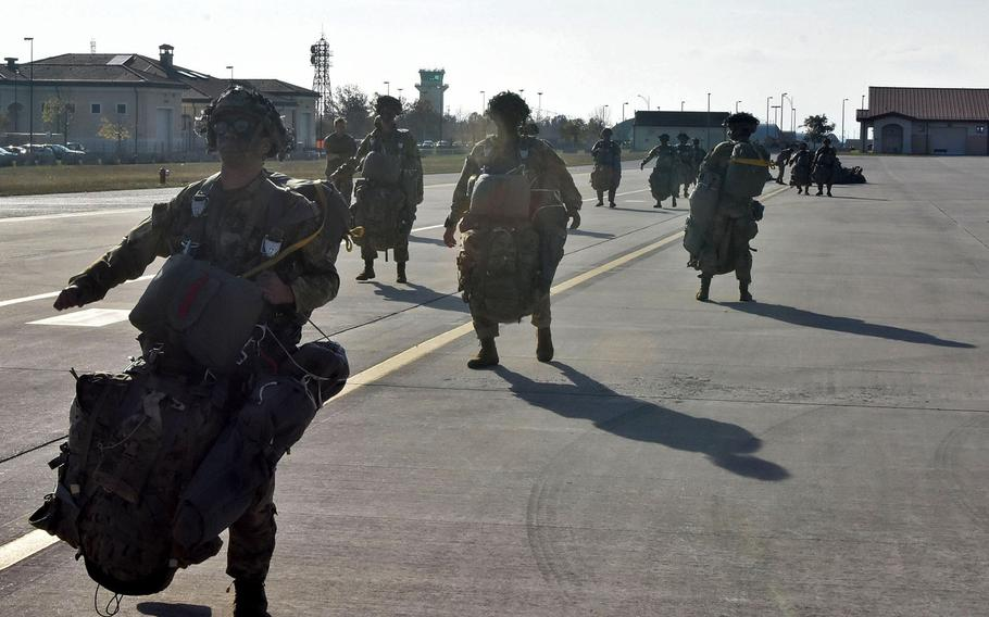 Soldiers from the 173rd Airborne Brigade, sporting between 70 and 90 pounds of gear, waddle out to a C-130J Hercules at Aviano Air Base, Italy, on Thursday, Nov. 15, 2018.