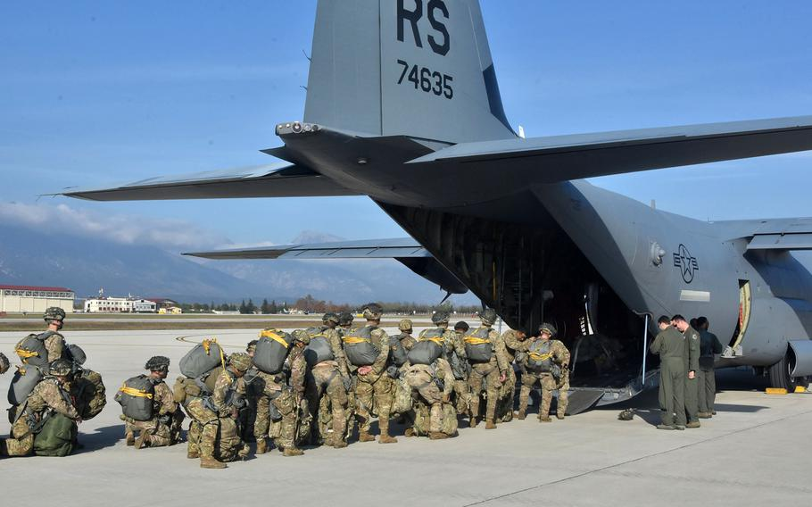 Soldiers from the 173rd Airborne Brigade get set to board a C-130J Hercules from the 86th Airlift Wing before jumping into France on Thursday, Nov. 15, 2018.