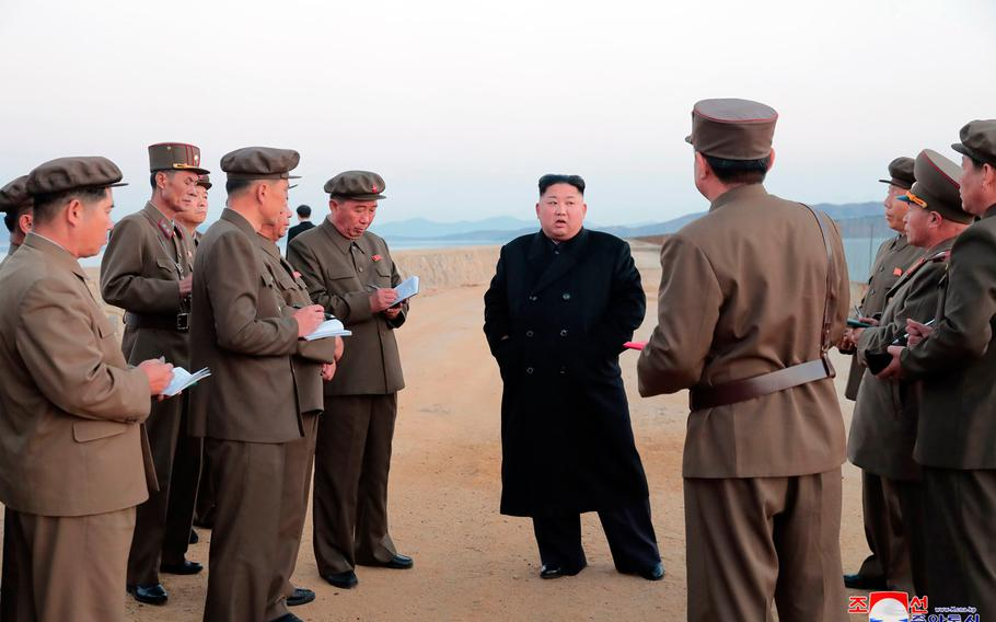 """In this undated photo released Friday, Nov. 16, 2018, by the North Korean government, North Korean leader Kim Jong Un, center, listens to a military official as he inspects a weapon testing at the Academy of National Defense Science, North Korea. Kim observed the successful test of a """"newly developed high-tech tactical"""" weapon, the nation's state media reported Friday, Nov. 16, 2018,  though it didn't describe what sort of weapon it was. Independent journalists were not given access to cover the event depicted in this image distributed by the North Korean government. The content of this image is as provided and cannot be independently verified. Korean language watermark on image as provided by source reads: """"KCNA"""" which is the abbreviation for Korean Central News Agency."""