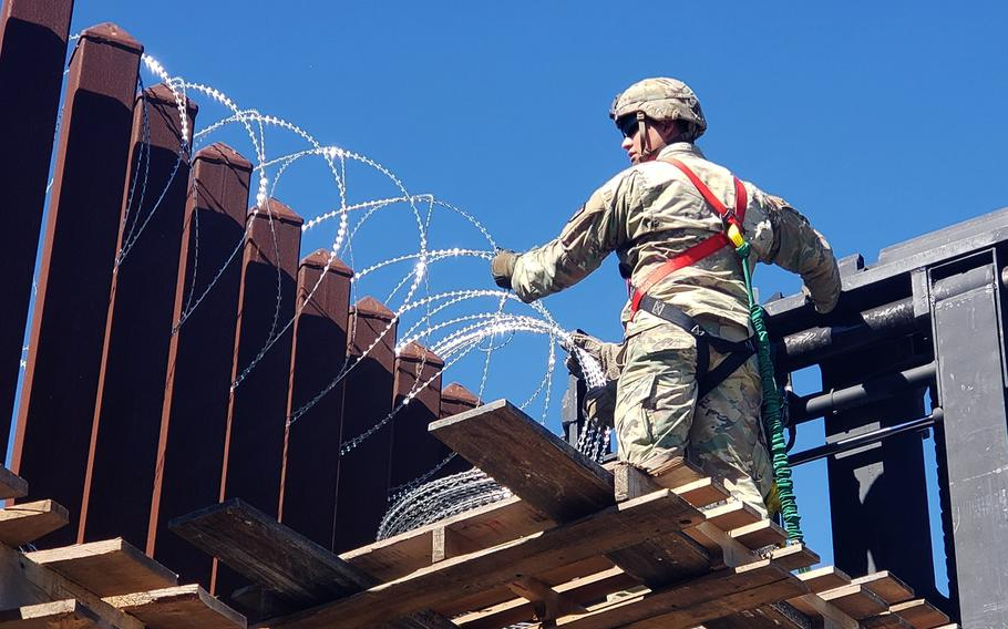 Soldiers from the 41st Clearance Company, 4th Engineer Battalion, 36th Engineer Brigade, Task Force Griffin, begin the process of hanging concertina wire as a deterrent along the southwest border, Nov. 16, 2018.
