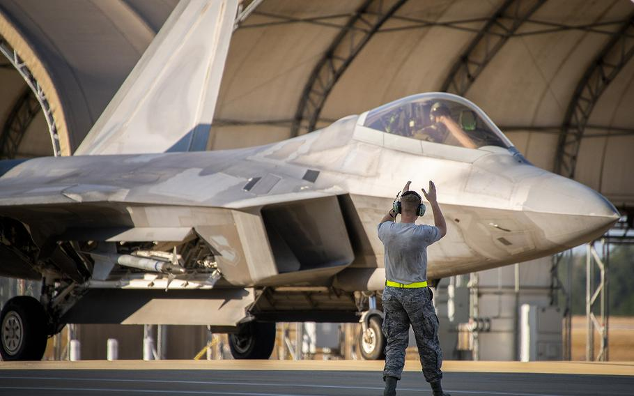 A maintenance airman guides in a 325th Fighter Wing F-22A Raptor at Eglin Air Force Base, Fla., Nov. 20.  The first six Raptors arrived to their temporary home at Eglin from Tyndall Air Force Base.  This move is part of mission shift by the Air Force as Hurricane Michael recovery efforts continue at Tyndall.
