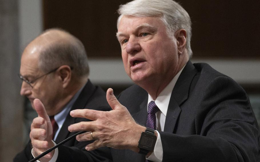 Retired Navy Adm. Gary Roughead, co-chair of the Commission on the National Defense Strategy, testifies at a Senate Armed Services Committee hearing on the commission's findings, Nov. 27, 2018 on Capitol Hill. Next to him is the other co-chairman, Ambassador Eric S. Edelman.