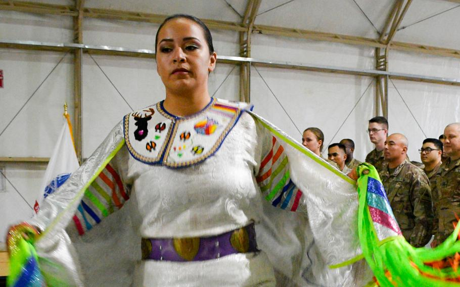 Army Pfc. Loretta Menchaca, 21, dances during a powwow at Camp Buehring in Kuwait Nov. 27