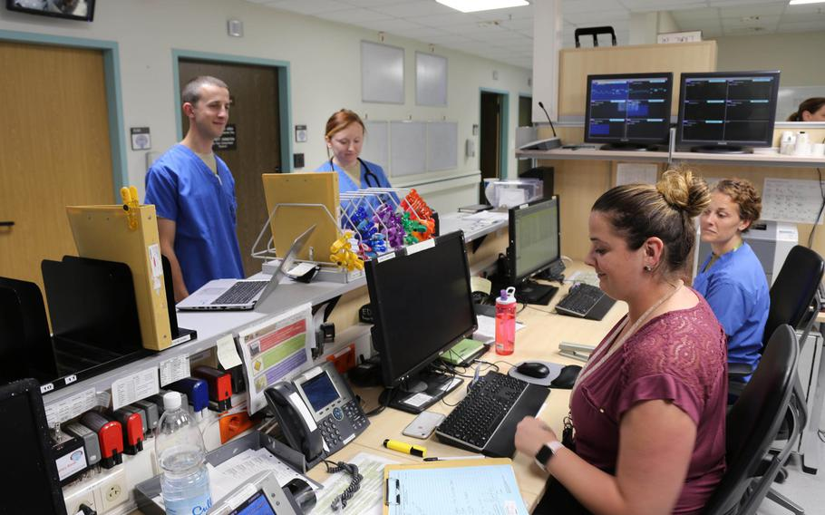 A mix of civilian and military workers staff the intake desk at the emergency room of Landstuhl Regional Medical Center. A recent GAO study outlined the difficulties the military has with shortages of civilian medical workers and recommended steps to address the issue.
