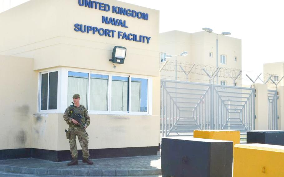 A guard stands duty at U.K. Naval Support Facility Bahrain.