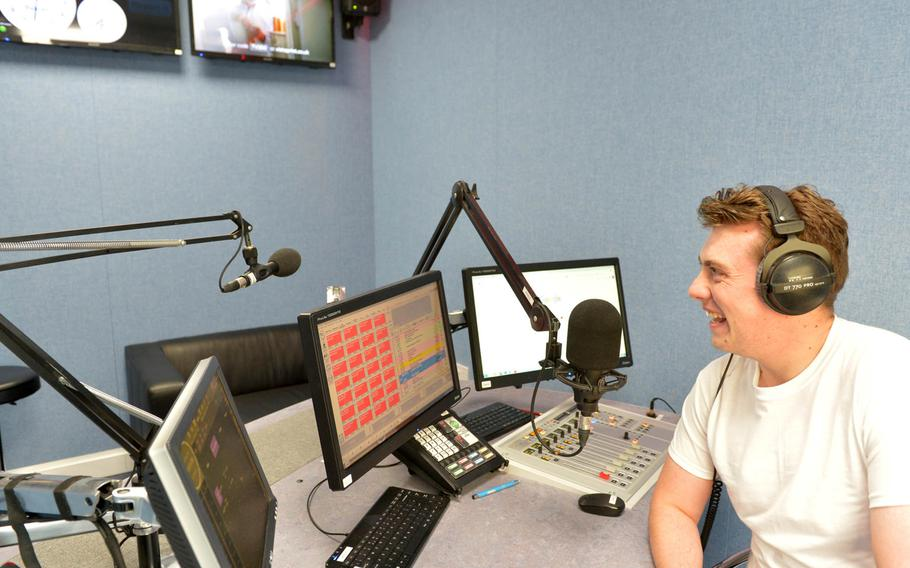 Tommy Parkinson of British Forces Radio hosts a daily show for forward deployed British troops at U.K. Naval Support Facility Bahrain.