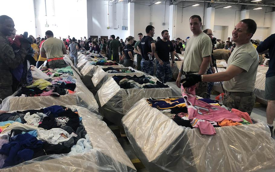 Hundreds of servicemembers and Guam residents packed 143 wooden boxes with donations Dec. 8 to be dropped by parachute to island residents during Operation Christmas Drop.