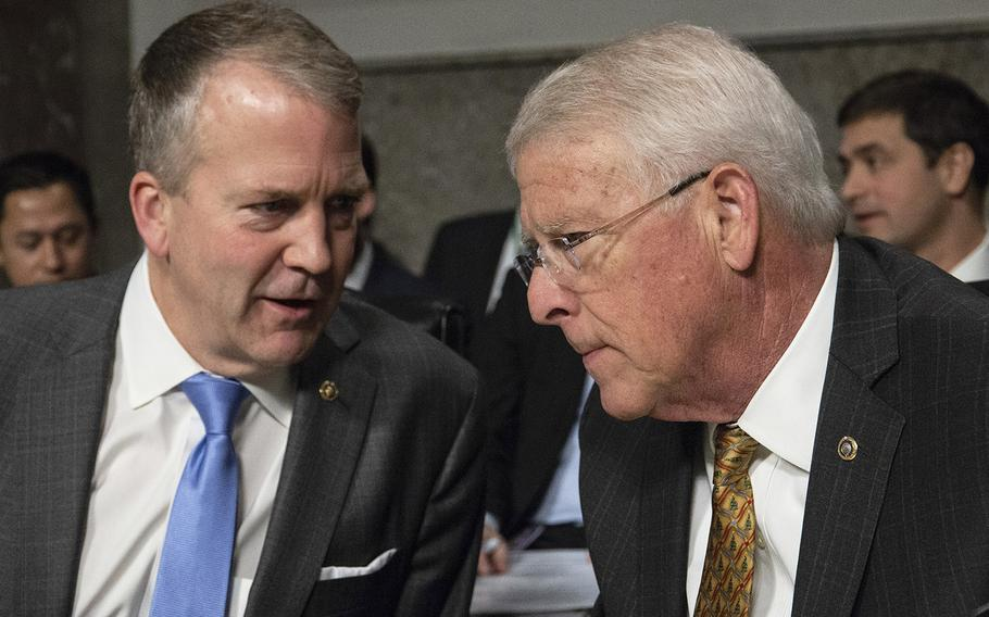 Sens. Dan Sullivan, R-Alaska, left, and Roger Wicker, R-Miss., confer before a Senate Armed Services subcommittee hearing on Navy and Marine Corps readiness, Dec. 12, 2018, on Capitol Hill. Sens. Roger Wicker, R-Miss., Angus King, I-Maine,and John Hickenlooper, D-Colo.,announced Thursday, Aug. 19, 2021, that they have tested positive for the coronavirus