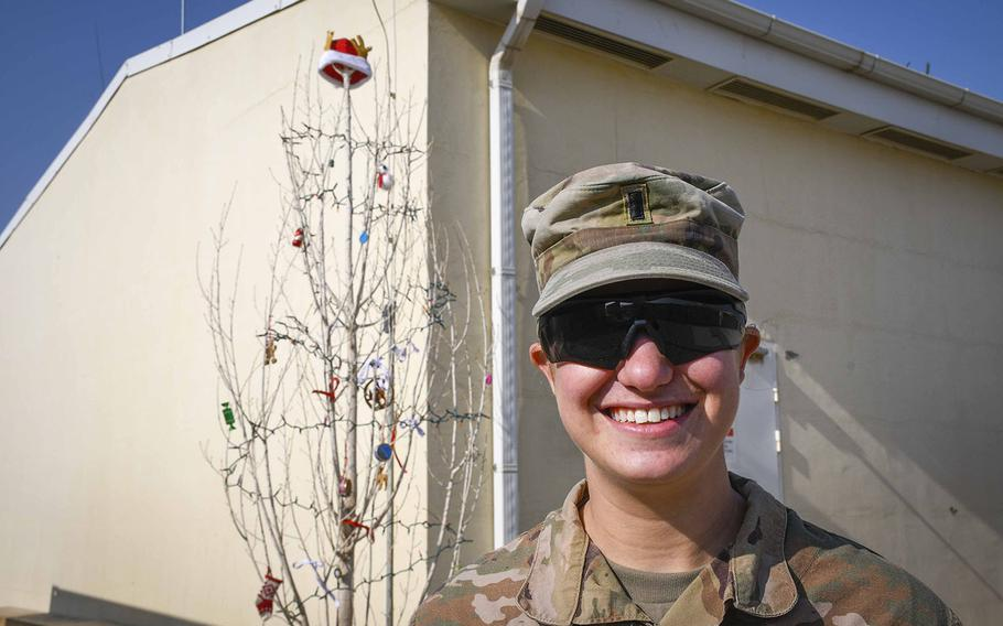 """1st Lt. Hannah Levine of Eagle Troop, 2nd Squadron, 1st Cavalry Regiment found what she described as the one living tree at the remote Camp Dahlke West in Afghanistan. She had the tree chopped down and decorated it. """"I was raised in a family where we don't believe in fake Christmas trees,"""" said Levine, 24, of Sugarloaf, Penn."""