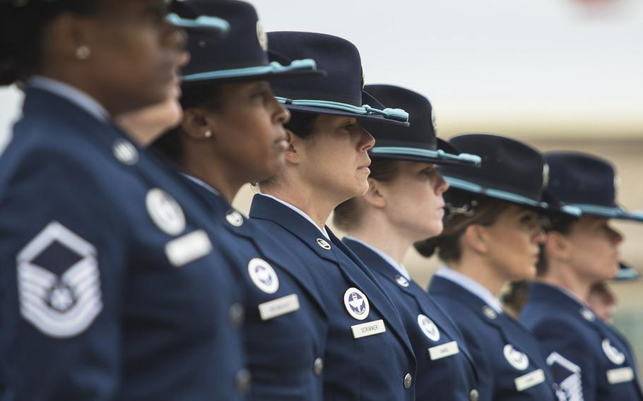 Military training Instructors with the 737th Training Group march in a all-female group during a basic military training graduation March 9, 2018 at Joint Base San Antonio-Lackland, Texas.