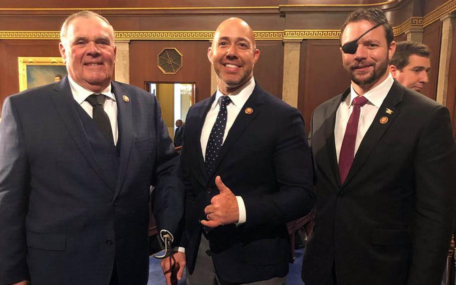 Rep. Brian Mast, R-Fla., center, poses with Rep. Jim Baird, R-Ind., left, and Rep. Dan Crenshaw, R-Texas, right, as the 116th Congress convenes Thursday, Jan. 3, 2019.