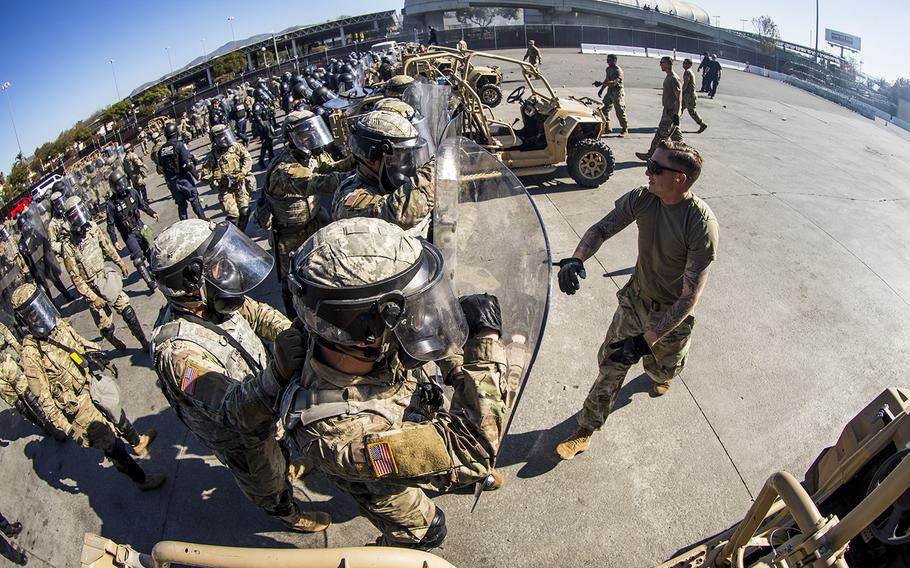 In a December 18, 2018 file photo, soldiers with 93rd Military Police Battalion, Special Purpose Marine Air-Ground Task Force 7, simulate resistance during civil disturbance training with U.S. Customs and Border Protection (CBP) at the Otay Mesa Port of Entry, Dec. 16, 2018.