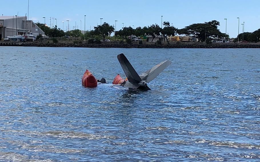 The tail section of a privately owned Hunter Hawker aircraft is salvaged in the waters off Honolulu, Jan. 8, 2019. The Coast Guard coordinated with the state of Hawaii and private parties to conduct the operation following the Dec. 12 crash.