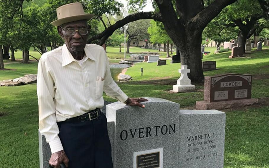 Richard Overton standing at his cousin Volma Overton's grave in the Texas State Cemetery in Austin. Richard Overton, a World War II veteran, will be buried Saturday in the cemetery just to the left of his cousin.