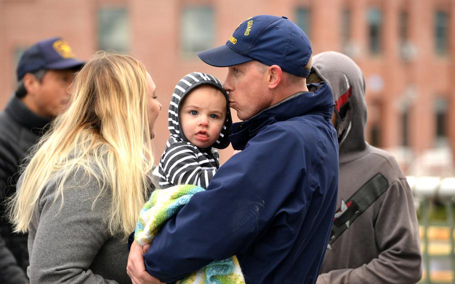 A Coast Guard Cutter Munro crew member embraces his son after the cutter returned home to Alameda, Calif., Dec. 24, 2018.