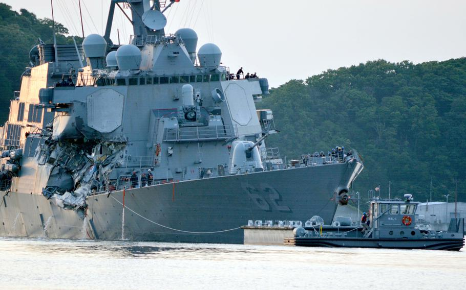 The guided-missile destroyer USS Fitzgerald returns to Yokosuka Naval Base, Japan, after a collision with a merchant vessel on June 17, 2017.