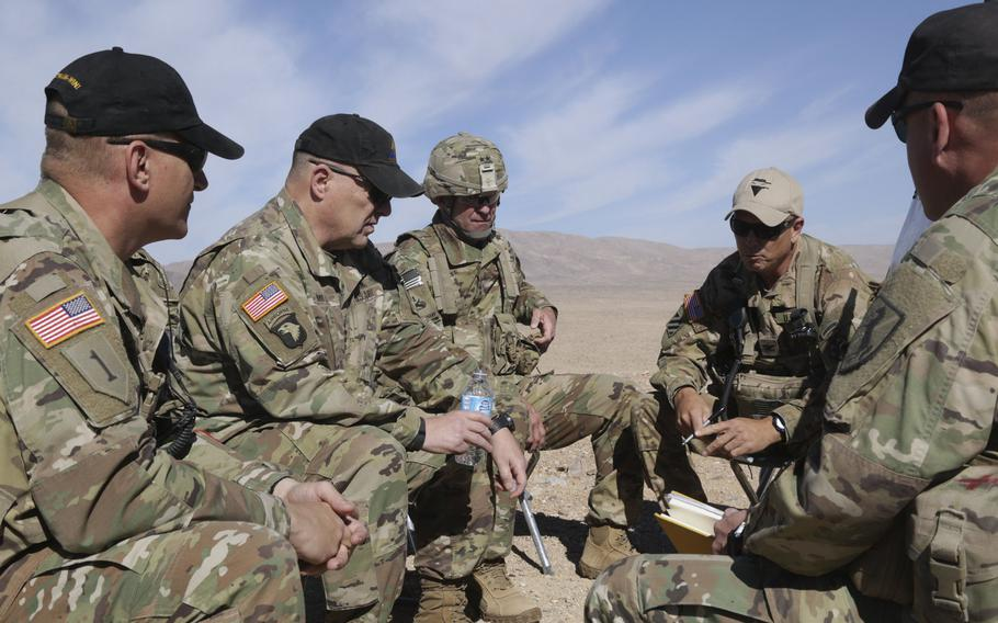 U.S. Army Chief of Staff Gen. Mark A. Milley, second from the left, visits with soldiers from the 1st Armored Division at the National Training Center at Fort Irwin, Calif., in 2016. Milley said Wednesday a push is under way to send more units to the National Training Center in Fort Irwin, Ca. and a similar center in Hohenfels, Germany.