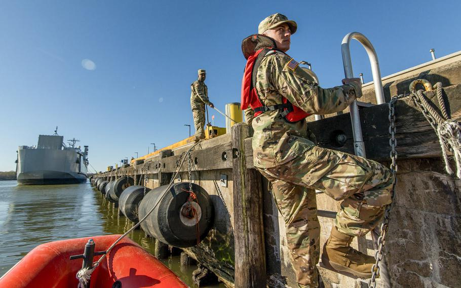 Spc. Dylan Nice, a U.S. Army Reserve watercraft operator from the 949th Transportation Company, a unit which specializes in watercraft operations, cargo and watercraft engineering, climbs a ladder from a rescue boat for a series in Baltimore in April 2017.  The Army is considering shuttering its National Guard and Reserve mariner units.