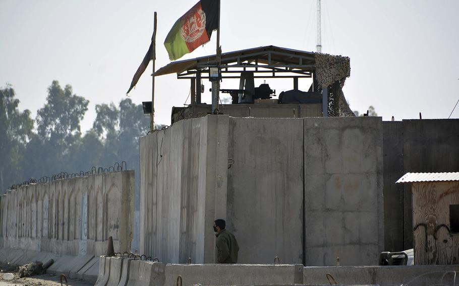 Afghan security personnel stand guard in the checkpoint of airport after a suicide attack in Jalalabad province, east of Kabul, Afghanistan, Wednesday, March 6, 2019.