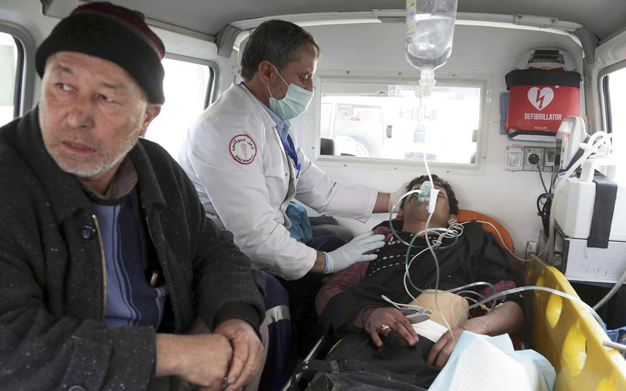 A man injured by an explosion is treated in an ambulance, in Kabul, Afghanistan, Thursday, March 7, 2019.