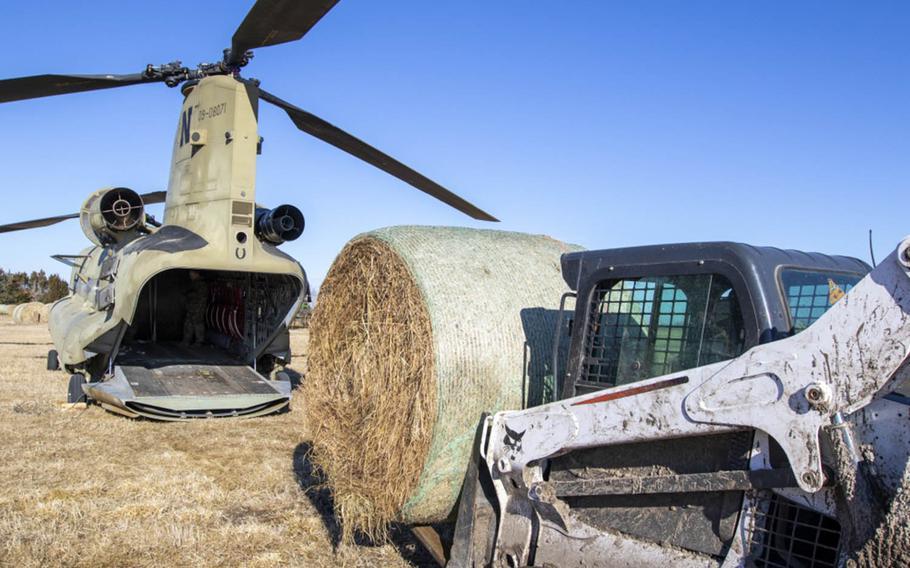 Nebraska Army National Guard Soldiers used a CH-47 Chinook helicopter to airdrop multiple bales of hay, March 20, 2019.