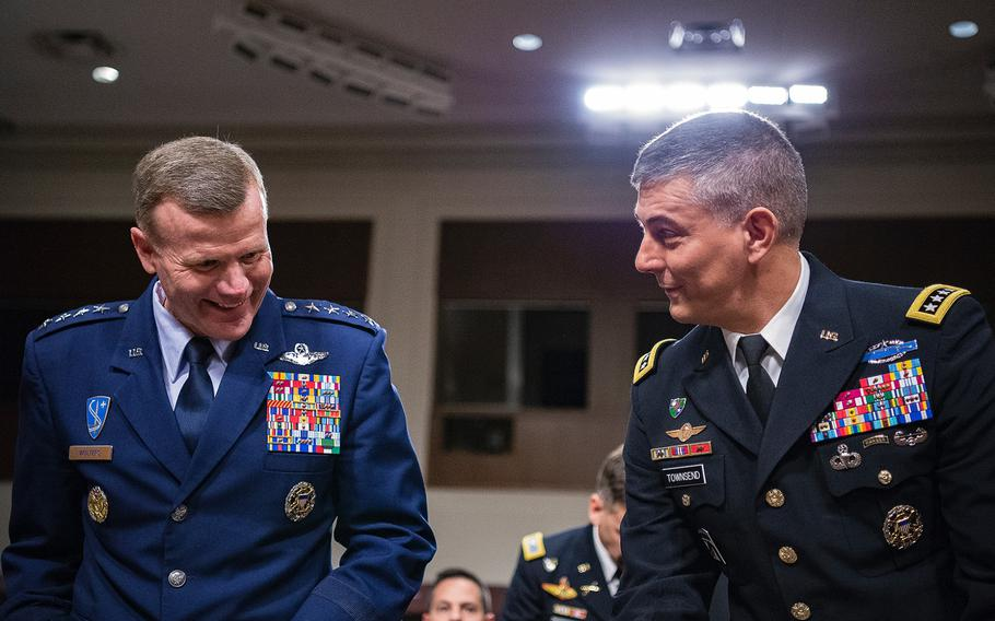 Gen. Tod D. Wolters, left, and Gen. Stephen J. Townsend share a laugh as they prepare to testify Tuesday, April 2, 2019, during a Senate Armed Services Committee hearing on Capitol Hill in Washington. Wolters has been nominated to head the European Command and Townsend to head the Africa Command.