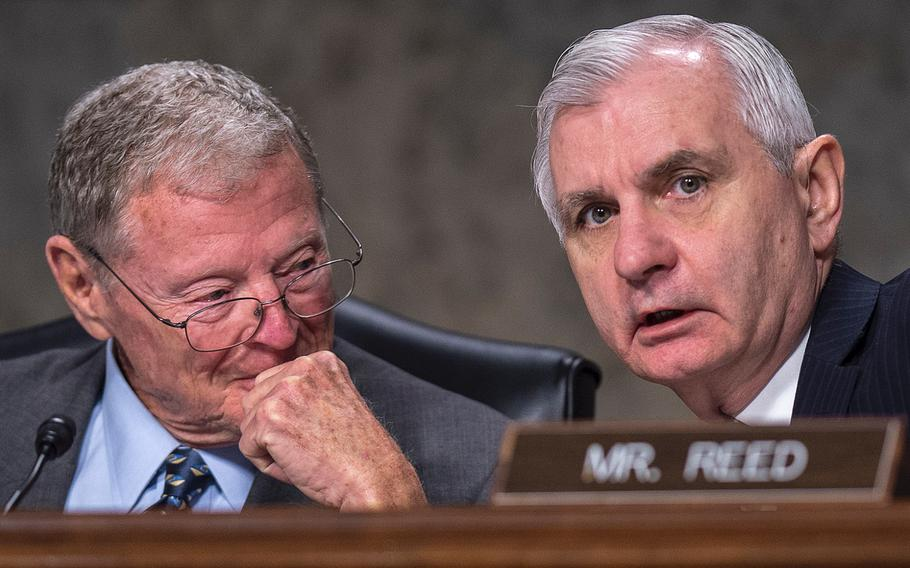 Senate Armed Services Committee Chairman Jim Inhofe, R-Okla. at left, and Ranking Member Jack Reed, D-R.I., confer with each other during a hearing on Capitol Hill in Washington on Tuesday, April 2, 2019.